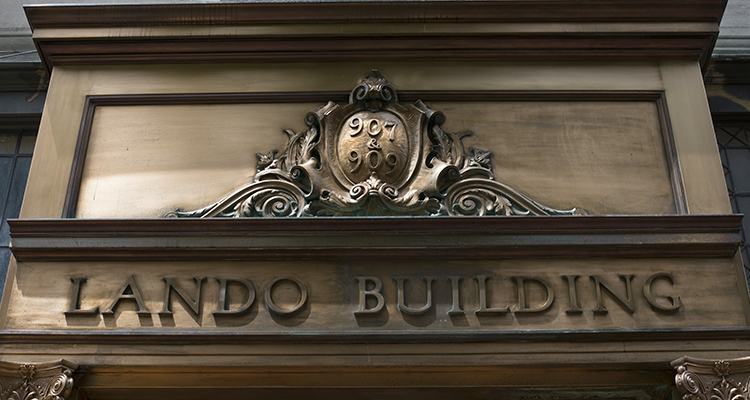 The original brass sign above the front door to the Lando Building. Photo by Martha Rial