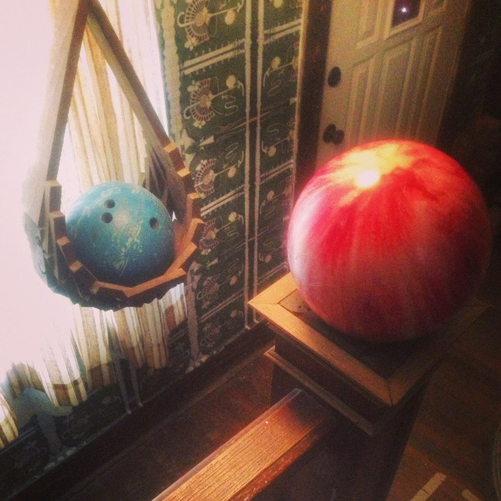 Bowling balls greet you at La Hutte Royal. Photo by Janna Leyde.