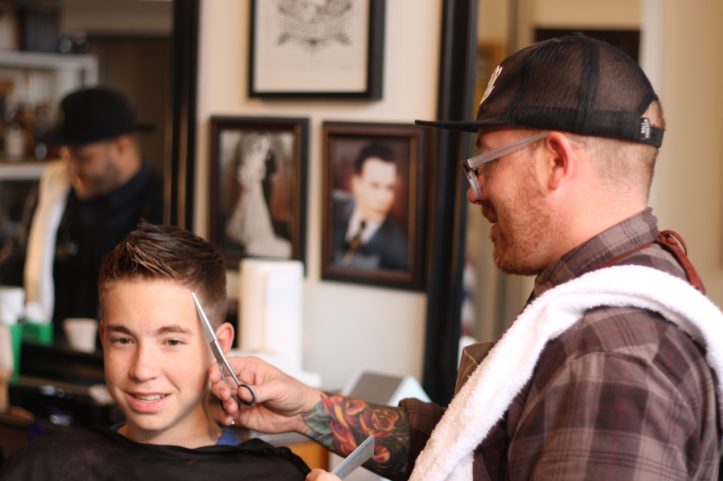 Ryan Graham, of Graham's Barbershop, cutting Everett Ziegenfuss, of Cranberry. Brian Conway photo.