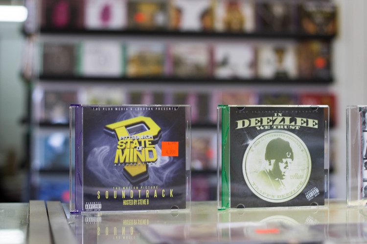 Local CD's and mixtapes for sale at Upbeat Records. Photo Credit: Brian Conway