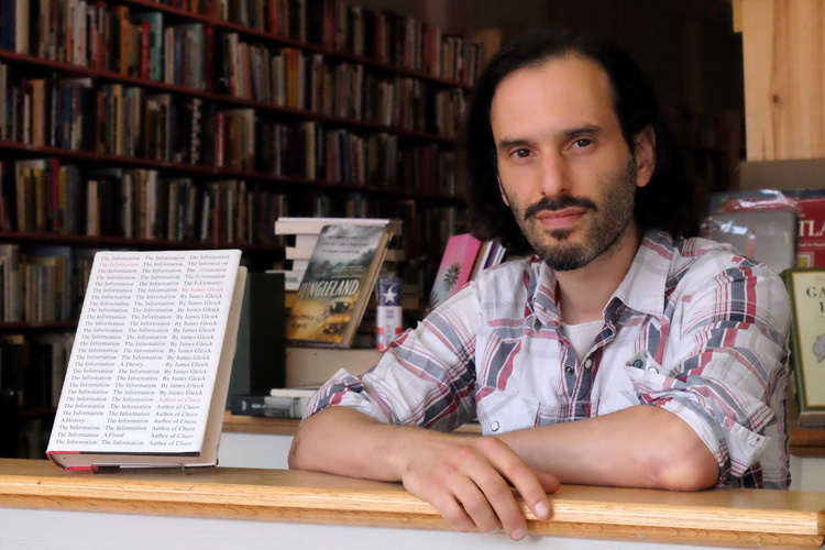 Eric Ackland, owner of Amazing Bookstore. Photo by Brian Cohen