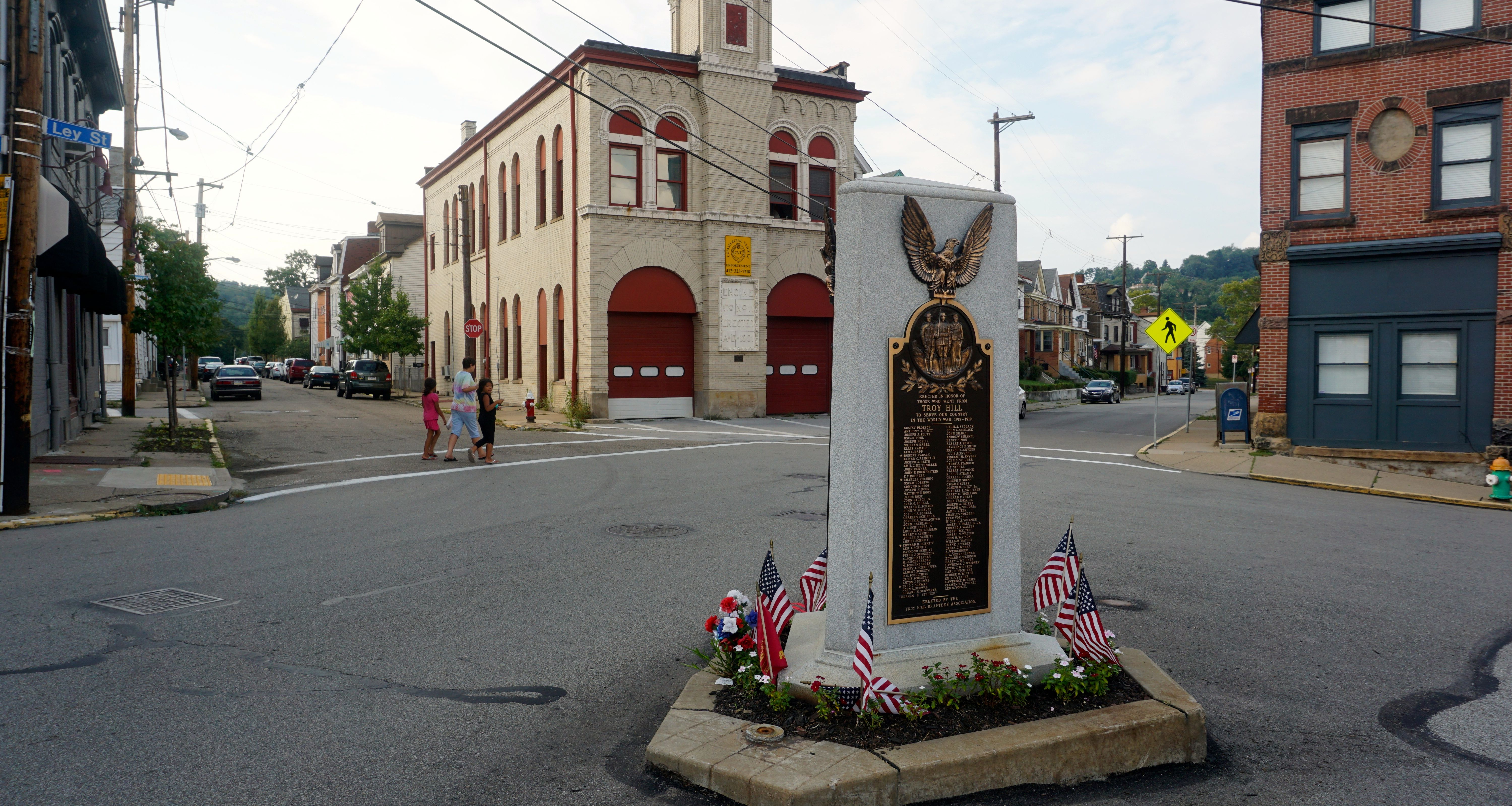 The memorial to veterans is a landmark in the main street of Troy Hill. TC photo