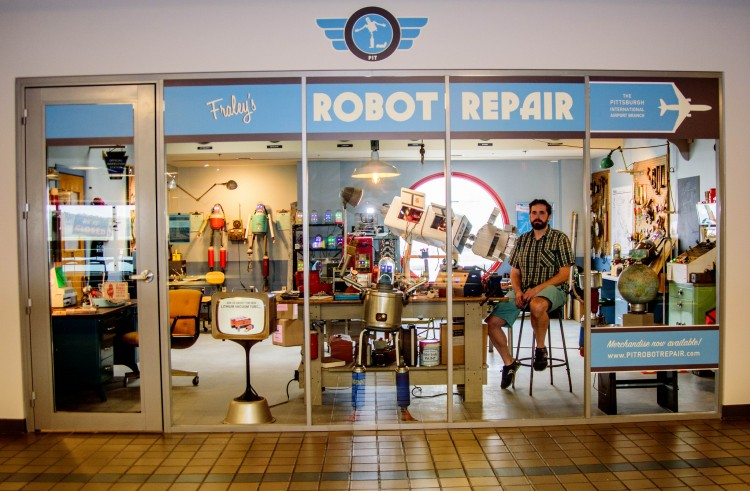 Toby Fraley in his Robot Repair Shop at the Pittsburgh Airport