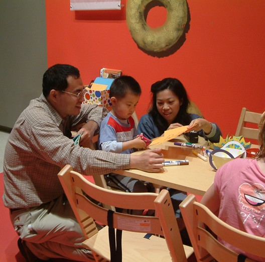Family time at a craft station during ARTventures. Photo: Carnegie Museum of Art.