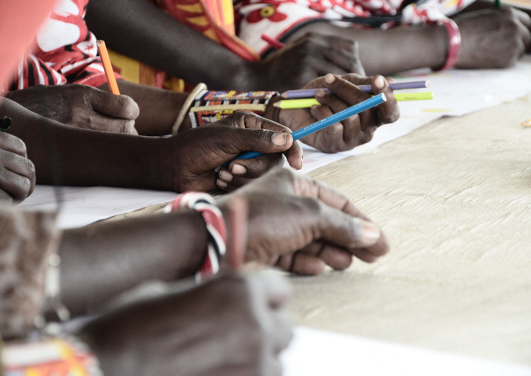 OMWA members sketching in the studio in Olorgesailie Kenya. Photo by Tereneh Mosely.