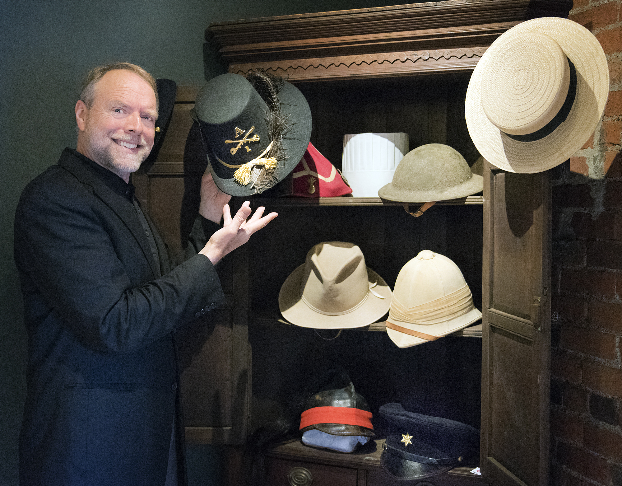 Andy with his historic hat collection.