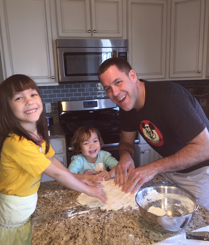 The Behr family making pizzas.