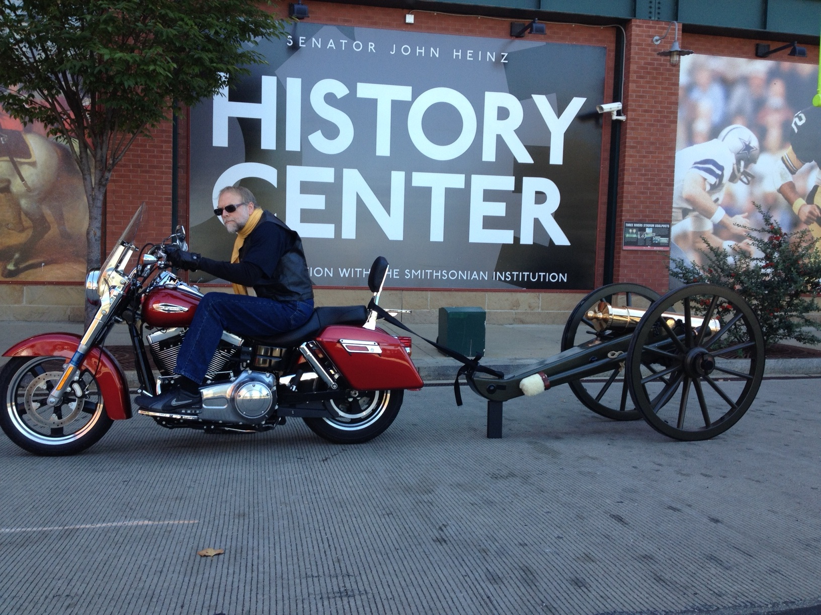 Andy and his motorcycle pulling his Civil War-era cannon.