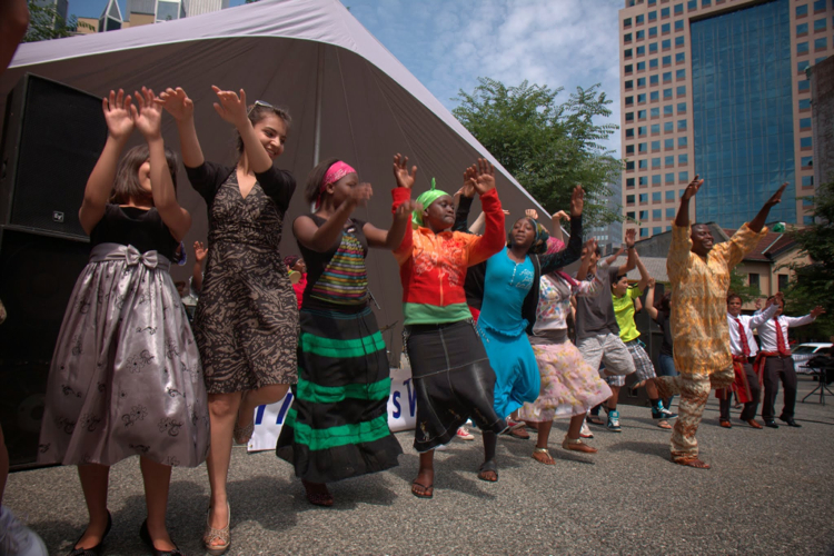 Afrika Yetu leads attendees in a dance that has all of Market Square moving. Photo: World Refugee Day.