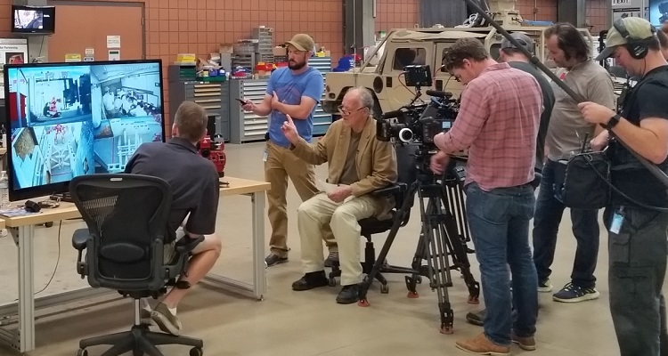 Werner Herzog (tan jacket) at the National Robotics Engineering Center. Photo by Byron Spice.