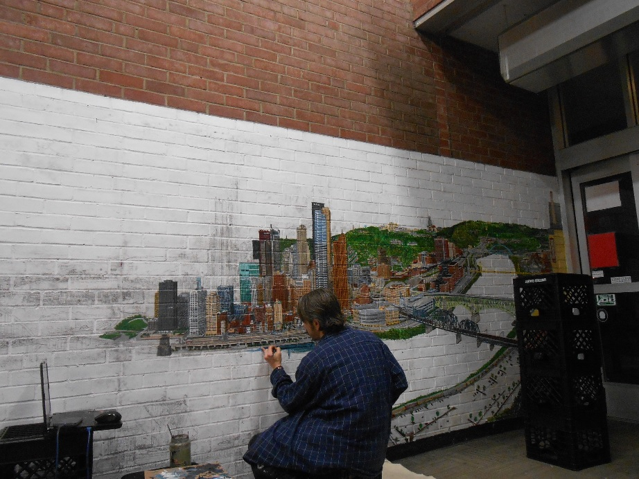 Artist Scott Saloney working on his Mt. Washington mural.
