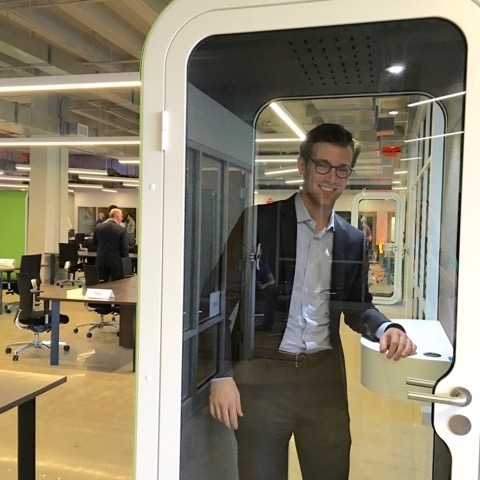 Jeremy Leventhal of Faros Properties in the phone booth at Alloy 26. Photo by Tracy Certo.