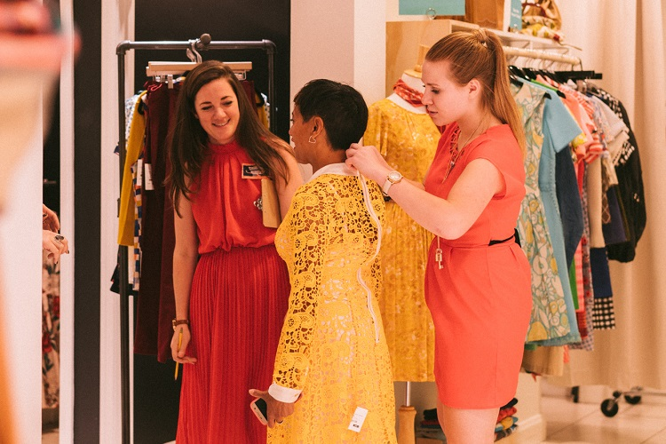 ModCloth stylists fit a customer at the Denver, CO pop-up shop. Image courtesy of ModCloth.