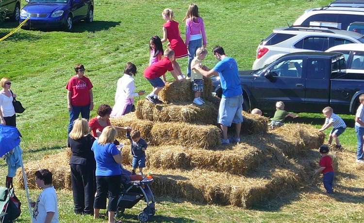Climbing the hay bale tower at Apple Castle. Image courtesy of Apple Castle.
