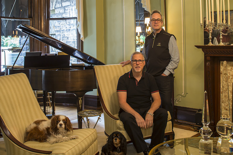 Bruce, seated, and Neill with their dogs in the parlor at 414 West North Avenue.