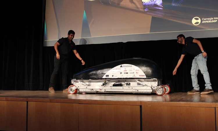 CMU Hyperloop founder Anshuman Kumar (right) and lead engineer Karthik Chandrashekaraiah (left) unveil their pod. Photo by Amanda Waltz.