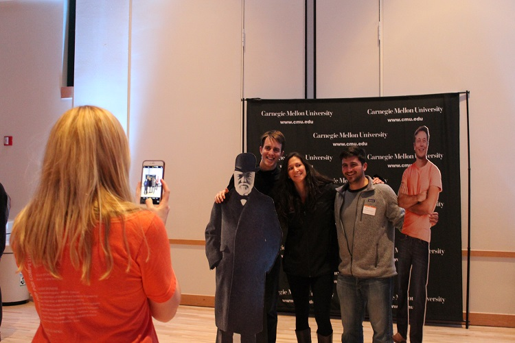 Guests pose with cutouts of Elon Musk and Andrew Carnegie. Photo by Amanda Waltz.