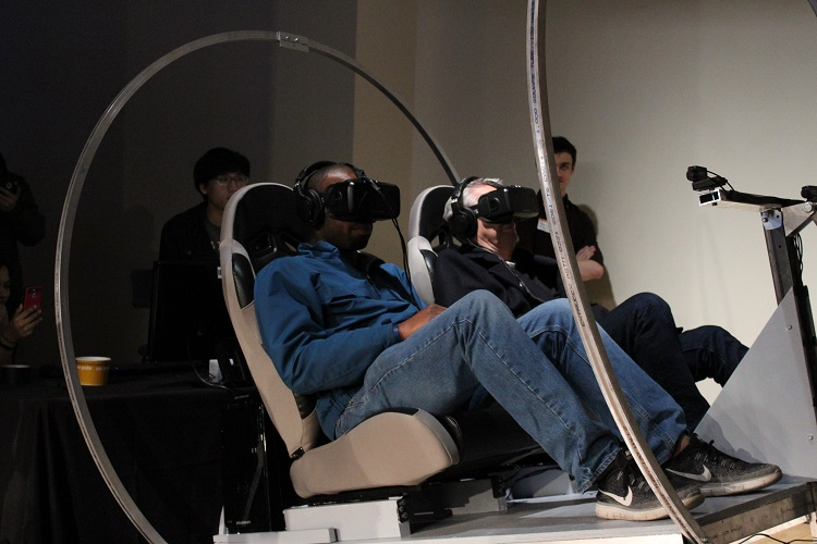 Volunteers experience Hyperloop speeds in the virtual reality simulator. Photo by Amanda Waltz.