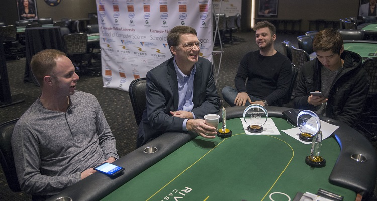 (From Left) Poker pro Jason Les chats with CMU professor Tuomas Sandholm, McAulay and Jimmy Chou at Rivers Casino.