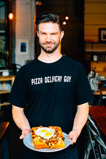 "Chef Pete Tolman of Iron Born Pizza with one of his ""Detroit-style"" creations, The Brunch Pie. Photo by Tom O'Connor."
