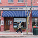 Walkers pass the Sewickley Hotel on Beaver Street. Photo by Kate Buckley