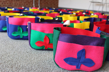 Messenger bags filled with vegetable seedlings will be worn during the Plant Parade. Photo courtesy of Mattress Factory