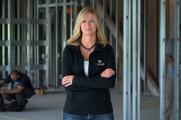 Traci Yates, business owner, at Rice Energy, a 17,000 sf project owned by Crossgates.  Photo by Brian Cohen.