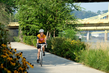 Biking the trail along the Three Rivers. Photo by Brian Cohen.