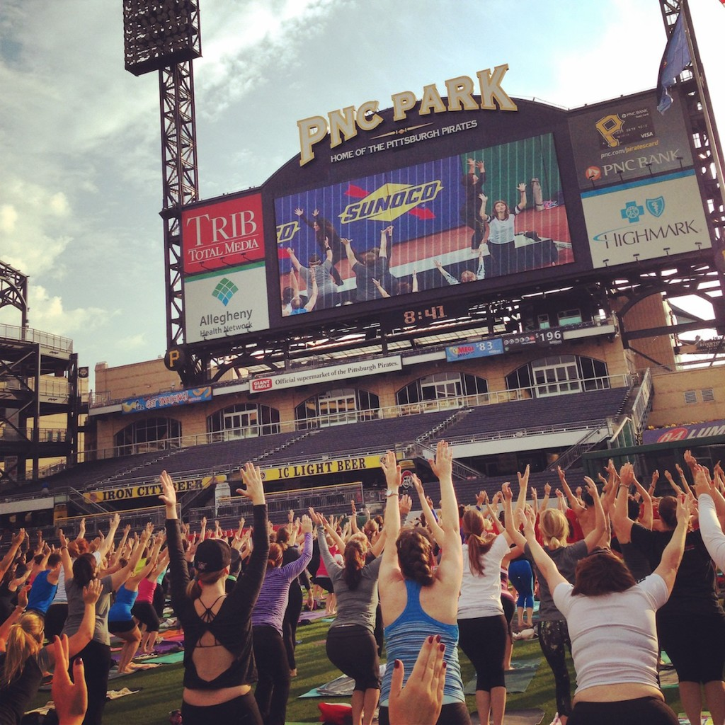 Yoga on the Jumbotron. Photo by Janna Leyde.