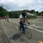 Riders use newly installed protected bikeway on Panther Hollow Trail.