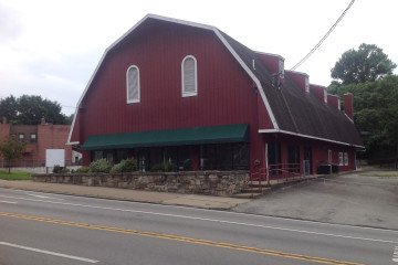 The former home of Rollier's Hardware, the big red barn will become Artsmiths.