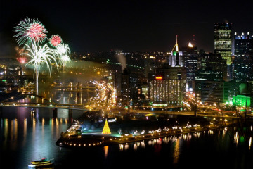Fireworks illuminate the Allegheny River over the party on the Roberto Clemente Bridge as Pittsburgh enters the 21st century.