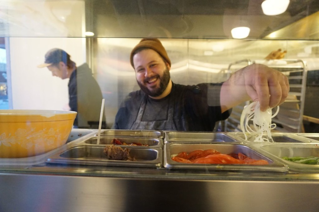 Anthony, the smiling owner of A' Pizza Badamo. Photo by TC Carlisle