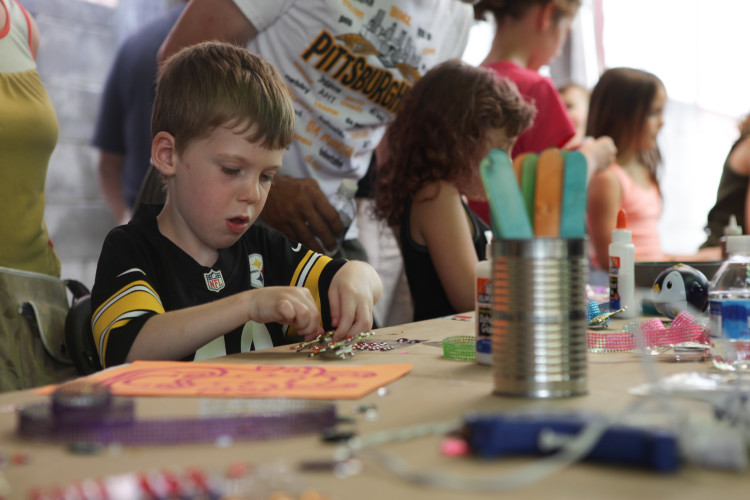 Children's activities at the Community Garden Party. Photo courtesy of Mattress Factory.