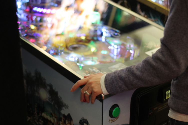 A guest plays pinball at Victory Pointe. Photo credit: Brian Conway