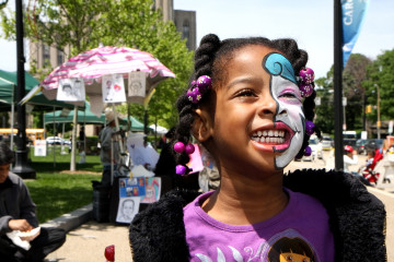 Schenley Plaza children  face painting braids girl purple summer festival happy (John Altdorfer)