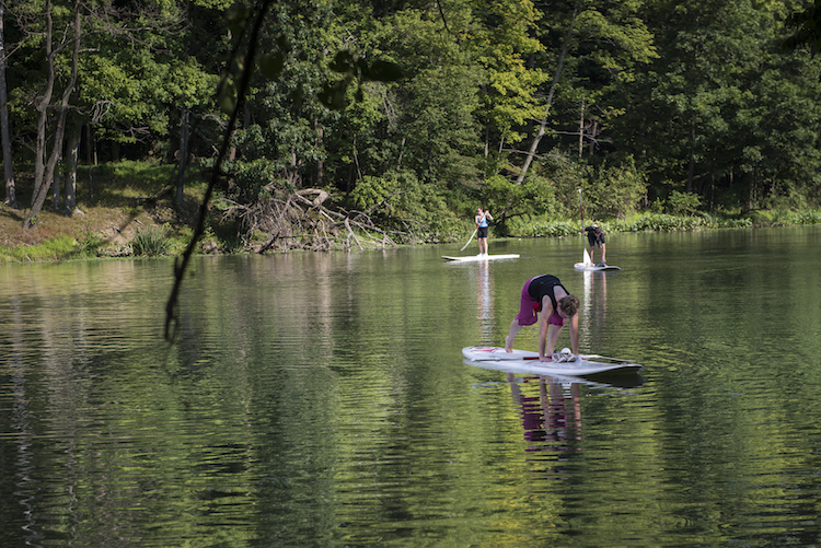 Paddleboard yoga from LL Bean. Photo by Erika Gidley.