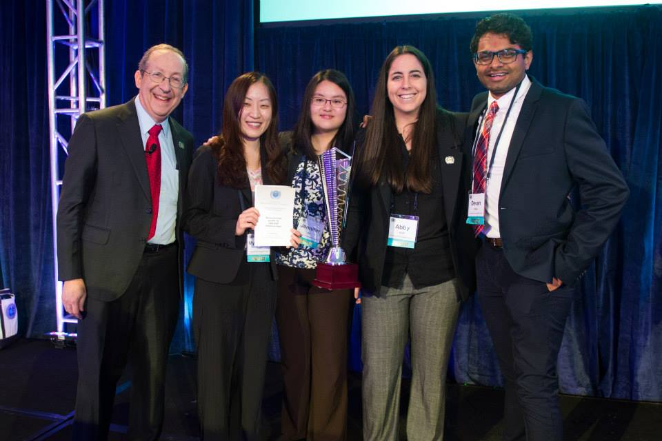 Team TOPCATS (L to R Myung Sun Choi, Jennifer Hu, Abby Koff, Devan Patel) with NBME executive director, Dr. Lewis First. Image courtesy of TOPCATS.