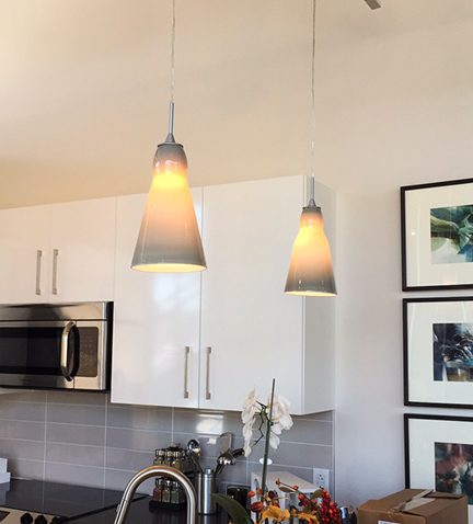 Pendant lights in the new Eastside Bond Apartments. Photo by Bridgeway Capital.