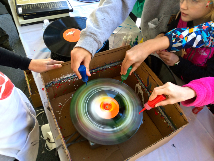 Making Spin Art using custom-made machines and recycled vinyl with Handmade Arcade at Maker Faire Pittsburgh. Photo by Handmade Arcade.