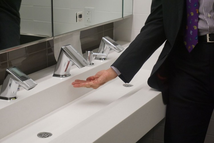 Each sink features a hand dryer in the faucet for a no-drip experience and a cleaner sink area.