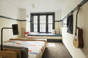 Rooms at Ace Hotel have more of a boarding house feel than a typical hotel. Photo by Rob Larson, courtesy Ace Hotel.