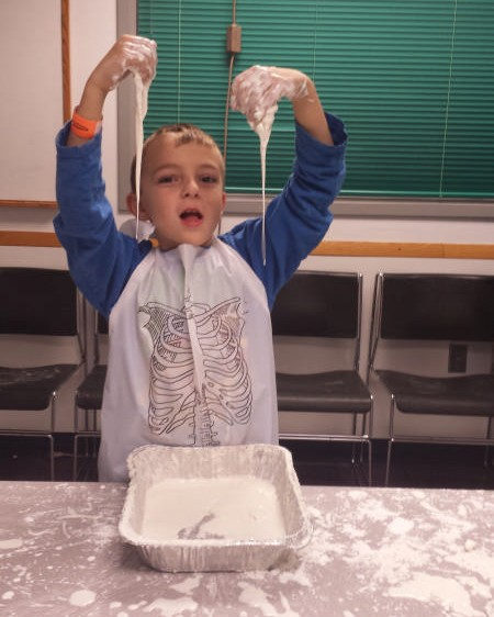 Getting messy at MessFest 2016. Photo courtesy Carnegie Science Center.