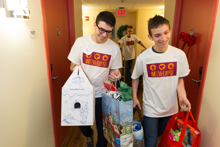 Mitzvah Day 2014: Volunteers at Ronald McDonald House clean, take presents to patients and prepare meals.