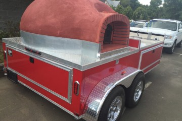 Pizzeria Il Pizzaiolo's food truck is a mini-brick oven on wheels. Photo courtesy Kevin Konn.