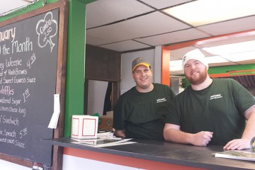 Tyler Sero, left, and Shane Feeney are two of the cofounders of Feeney's Weenies, which opened in Beechview in November. Photo by Kim Lyons.