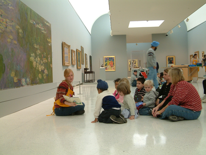 Participating in an ARTventures program for families in the Scaife Galleries. Photo: Carnegie Museum of Art.