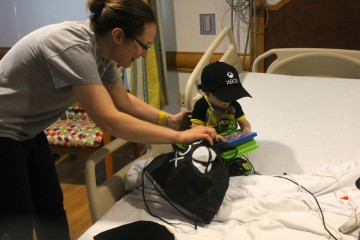 Young transplant patient Case checks out some Xbox games. Courtesy Virginia Montanez.