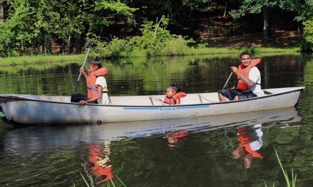 Activities like canoeing help kids gain new skills and confidence. Photo courtesy of Amachi Pittsburgh.