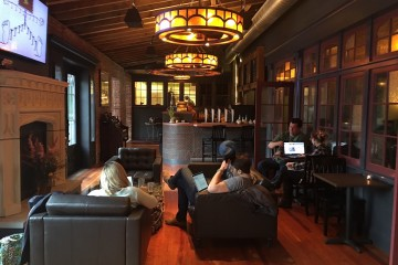 A warm and inviting room for coffee at The Abbey on Butler St.